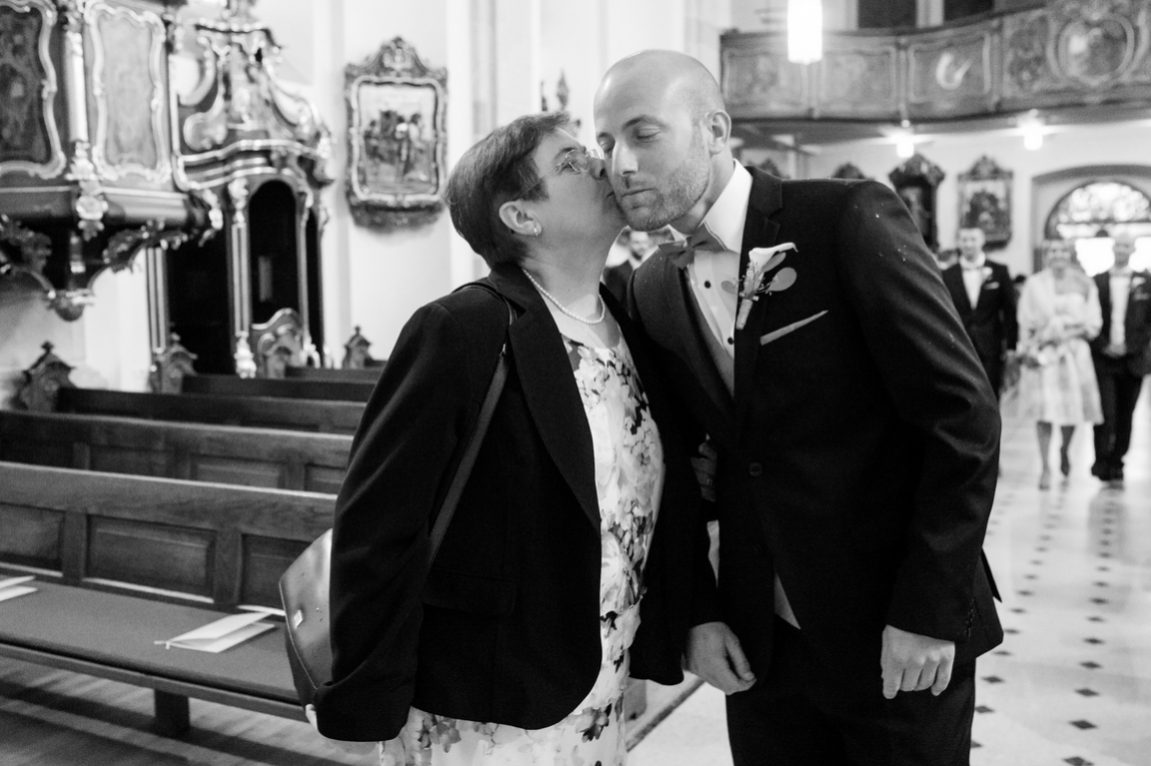 Black and white photographer Mondorf Les Bains Luxembourg- The mother kiss his son -www.gregory clement.fr
